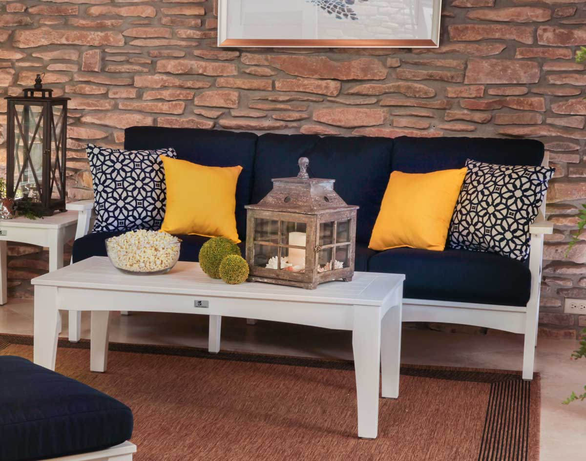 Poly Lumber Classic Terrace Sofa Shown In White With Canvas Navy Cushions  And Optional Pillows And Coffee Table
