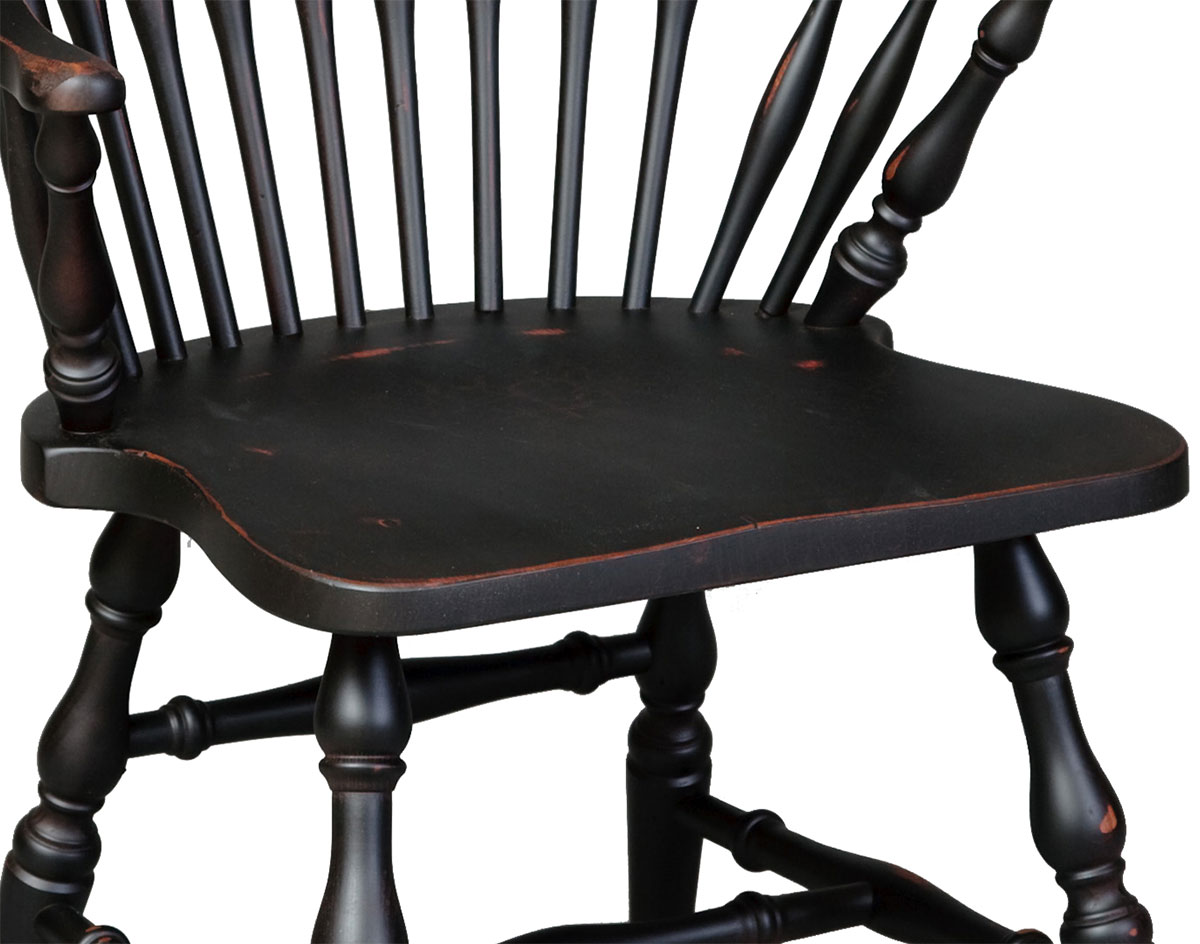 Close Up Of Seat Of Vintage Windsor Arm Chair Shown In Antiqued Black Finish